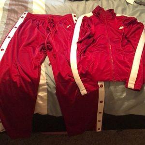 Maroon Nike sweats and jacket
